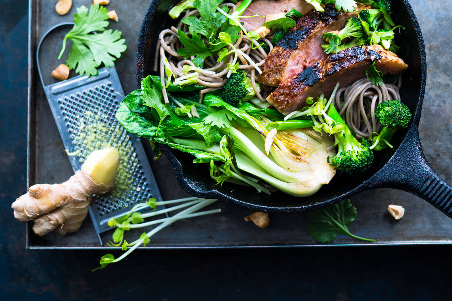 Asian duck stir fry with noodles in a pan
