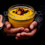 Roasted carrot soup hold in a glas